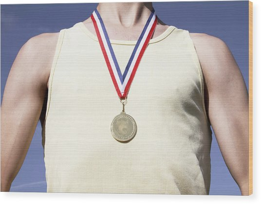 . Athlete With Gold Medal Wood Print by Tom and Steve