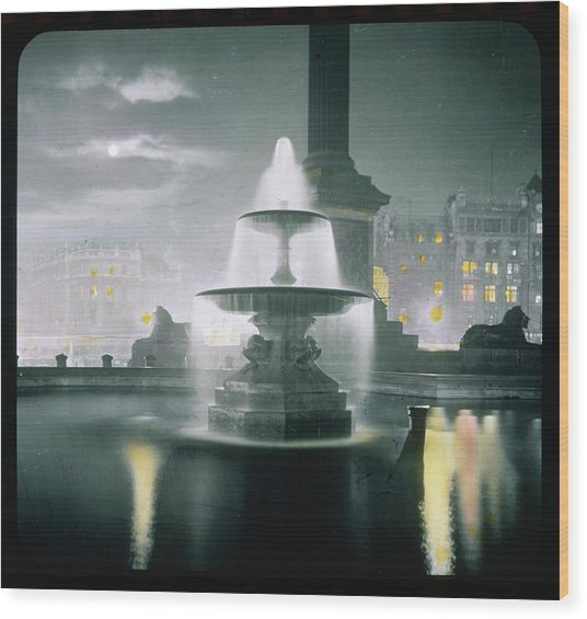 Trafalgar Square At Night  Showing Wood Print by Mary Evans Picture Library
