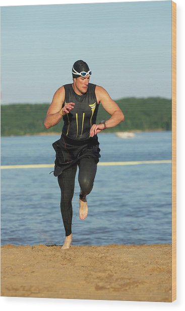 A Male Athelete Running Wood Print