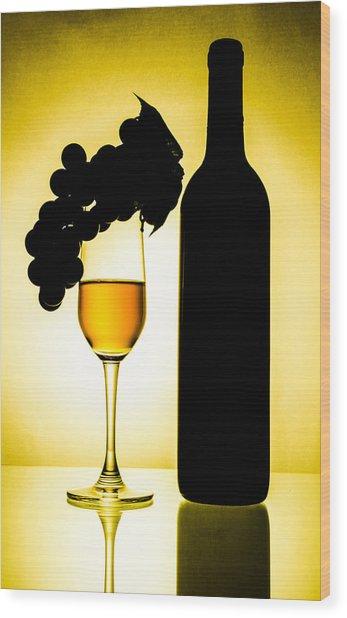 Bottle And Wine Glass Wood Print by Sirapol Siricharattakul