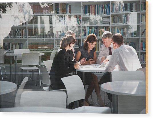Businesspeople In Office Meeting Wood Print by Tom Merton