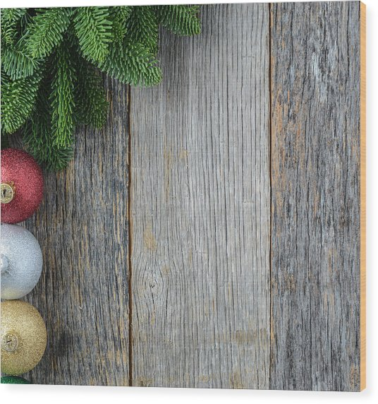 Christmas Pine Needle And Ornaments On A Rustic Wood Background Wood Print