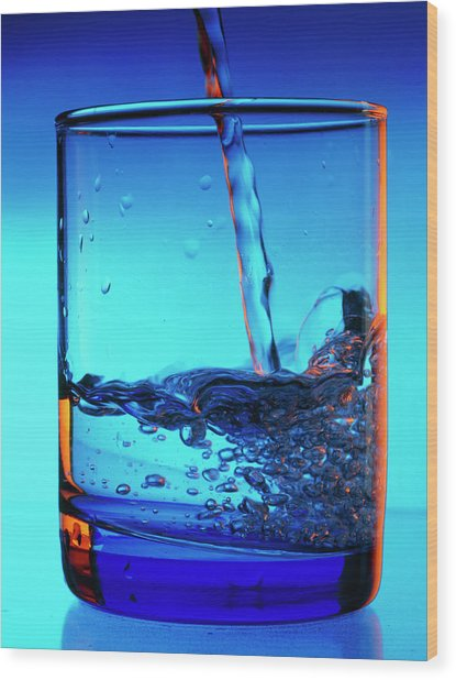 Drinking Water Pouring Into A Glass Wood Print