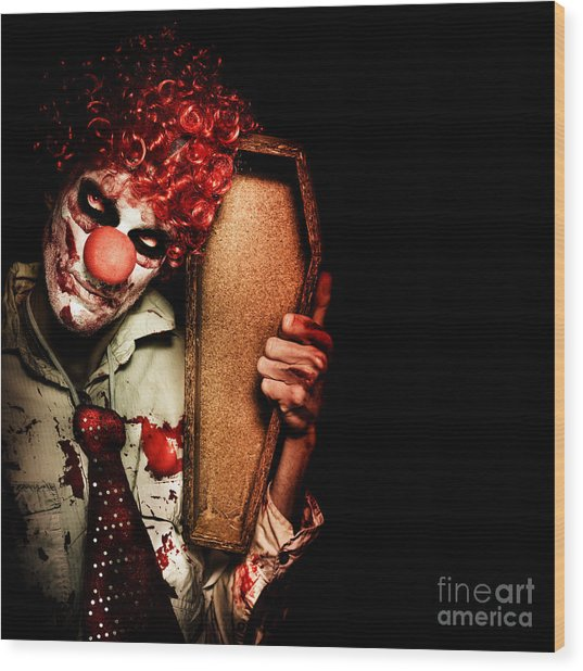 Evil Horrible Clown Holding Coffin In Darkness Wood Print