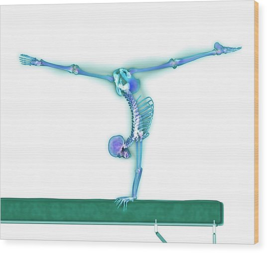 Gymnast Balancing On A Beam Wood Print by Gustoimages/science Photo Library