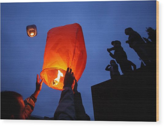Launching Wish Lanterns Wood Print by Science Photo Library