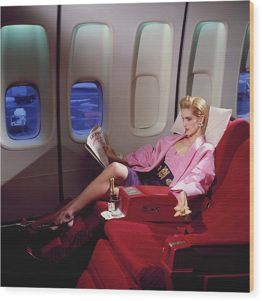 Model Wearing Pink Jacket On Airplane Wood Print