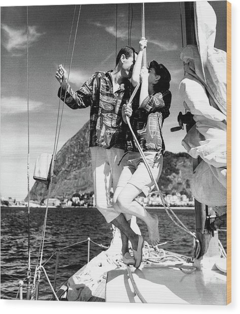 Models Wearing A Bennett Shirts On A Sailboat Wood Print by Richard Waite