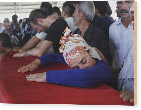 Mourners Attend The Funerals Of Those Killed In The Turkish Bomb Blast Wood Print by Gokhan Sahin