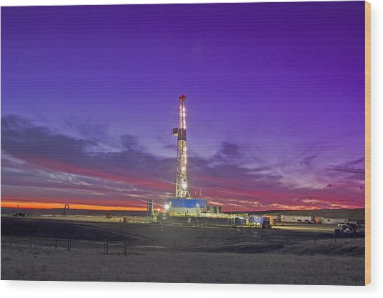Oil Fracturing Drilling Rig At Dusk Wood Print by Rich LaSalle