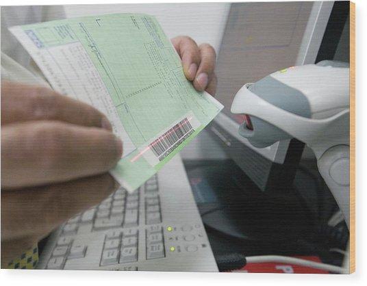 Pharmacist Scanning A Barcode Wood Print