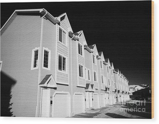 row of condominium starter homes during winter Saskatoon Saskatchewan Canada Wood Print
