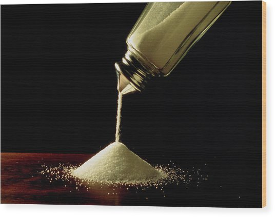 Salt Pouring From Salt Container Wood Print