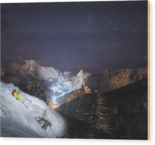 Skier Riding Down A Powder Slope At Night Wood Print by Leander Nardin