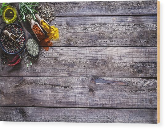 Spices And Herbs On Rustic Wood Kitchen Table Wood Print by Fcafotodigital