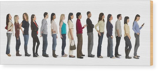 Studio Shot Of People Waiting In Line Wood Print by Tetra Images