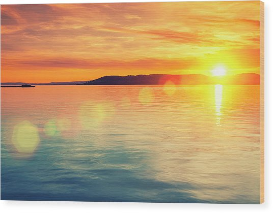 Sunset Over Water Wood Print by Focusstock