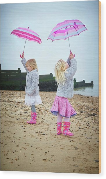 Two Girls On Beach Holding Umbrellas Wood Print by Ruth Jenkinson