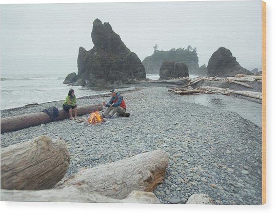 Two Hikers Enjoy A Campfire On A Beach Wood Print