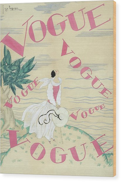 Vogue Magazine Cover Featuring A Woman Standing Wood Print by Georges Lepape