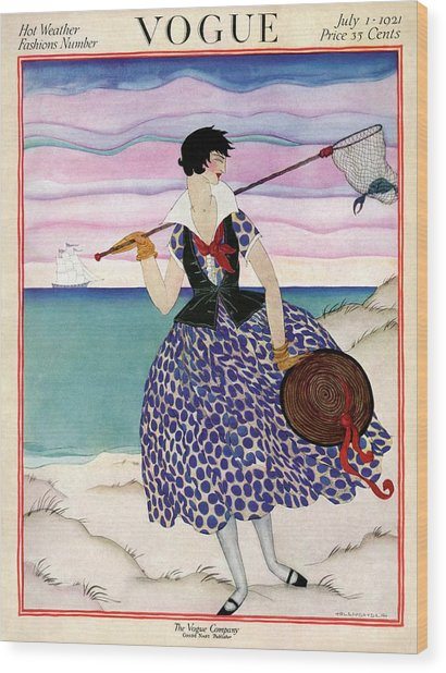 A Vogue Magazine Cover Of A Woman Wood Print