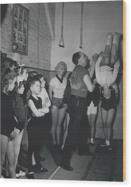 Aspiring Acrobats Wood Print by Retro Images Archive