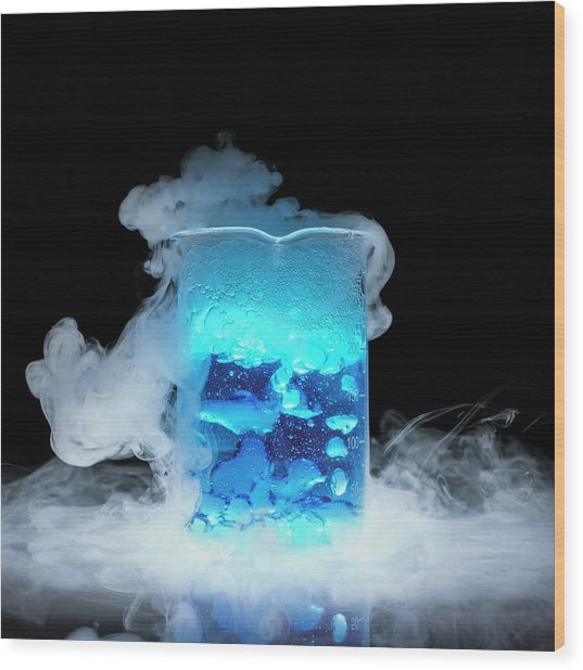 Dry Ice Vaporising Wood Print by Science Photo Library