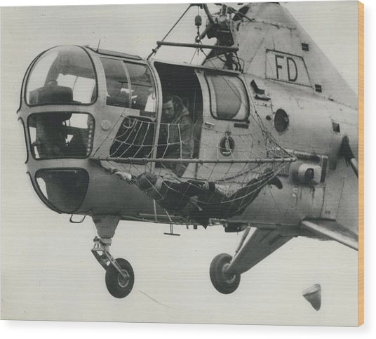 Helicopter Rescue - Royal Navy Adopts New Apparatus Wood Print by Retro Images Archive