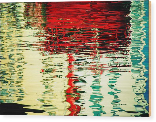 Reflection In Water Of Red Boat Wood Print