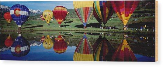 Reflection Of Hot Air Balloons Wood Print