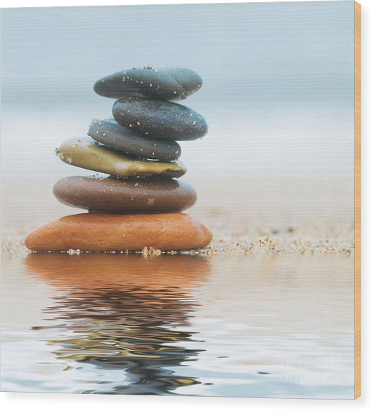 Stack Of Beach Stones On Sand Wood Print