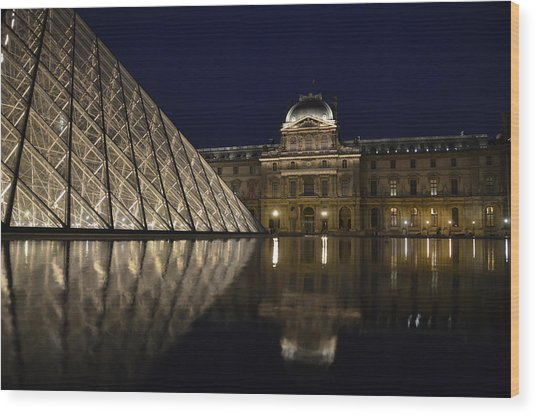 The Louvre Palace And The Pyramid At Night Wood Print
