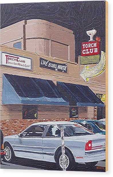 The Torch Club Wood Print by Paul Guyer