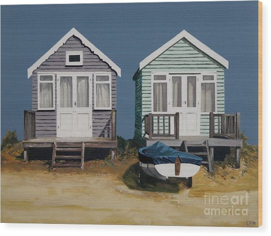 Two Beach Huts And Boat Wood Print by Linda Monk