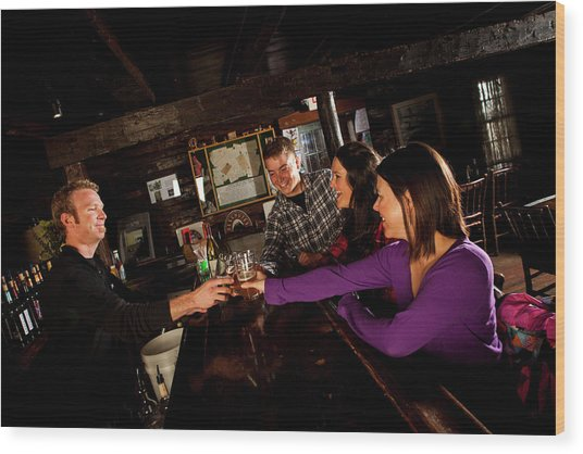 Two Men And Two Women Having Beer Wood Print