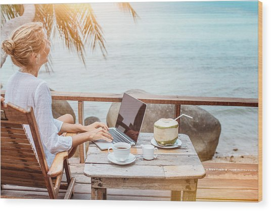 Young Woman Working On Laptop With Coffee And Young Coconut Wood Print by Jasmina007