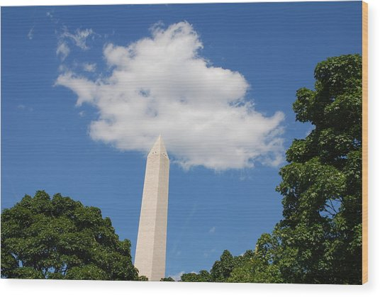 Obelisk Rises Into The Clouds Wood Print