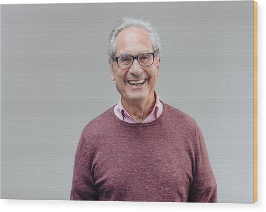 Portrait Of A Smiling Senior Business Man Wood Print by Serts