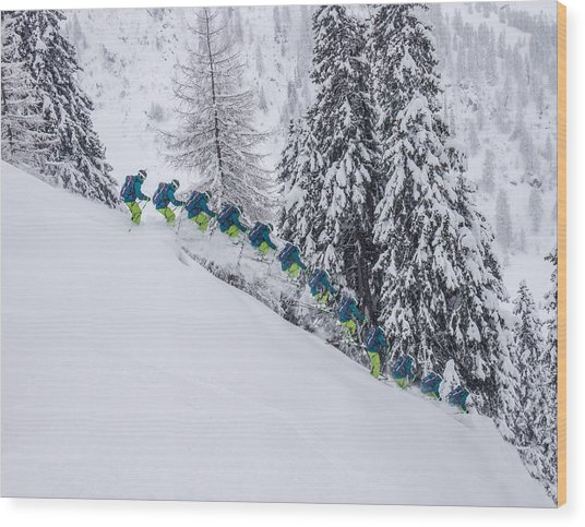 Young Male Freerider Skiing Down A Powder Slope Wood Print by Leander Nardin