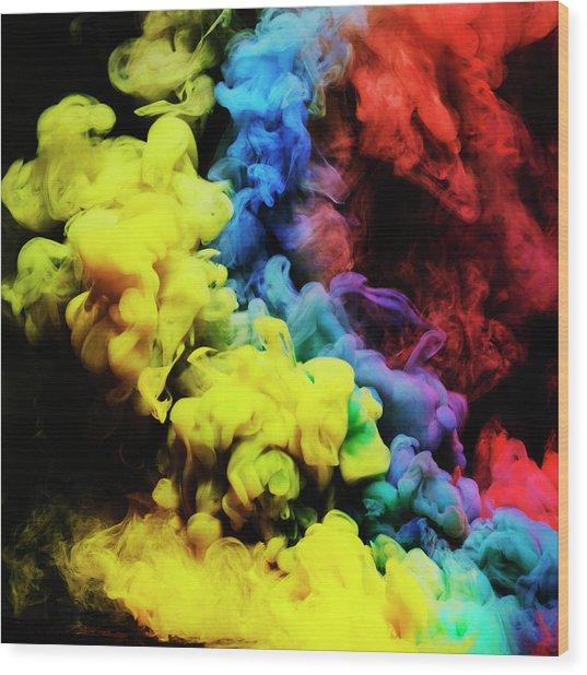 Coloured Smoke Mixing In Dark Room Wood Print by Henrik Sorensen