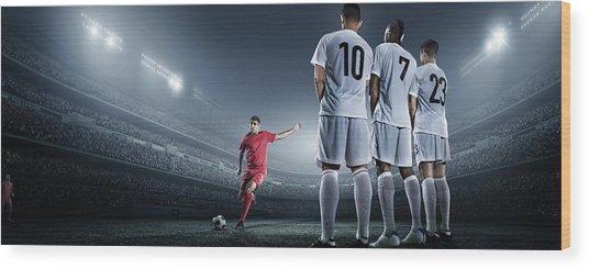 Soccer Player Kicking Ball In Stadium Wood Print by Dmytro Aksonov