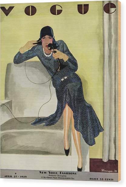 A Vintage Vogue Magazine Cover Of A Woman Wood Print by Pierre Mourgue