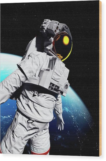Astronaut In Space Wood Print by Sciepro/science Photo Library