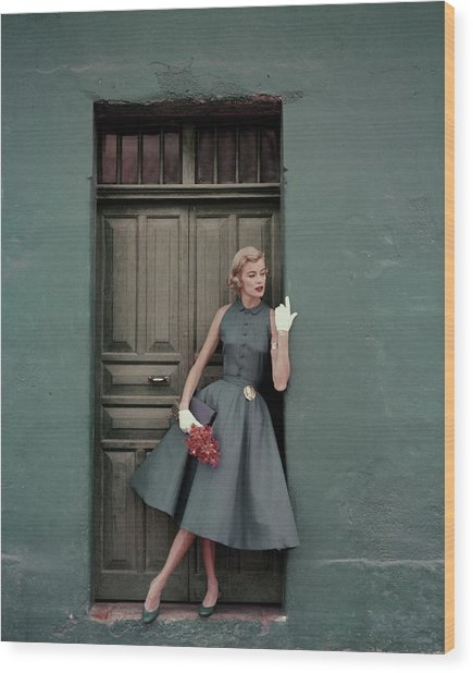 A 1950s Model Standing In A Doorway Wood Print by Leombruno-Bodi