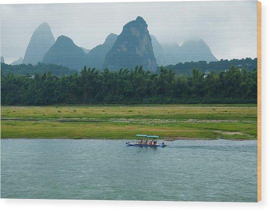 A Bamboo Raft Along The Li River In Wood Print