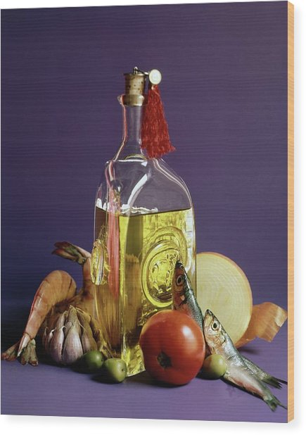 A Bottle Of Olive Oil Surrounded By A Variety Wood Print