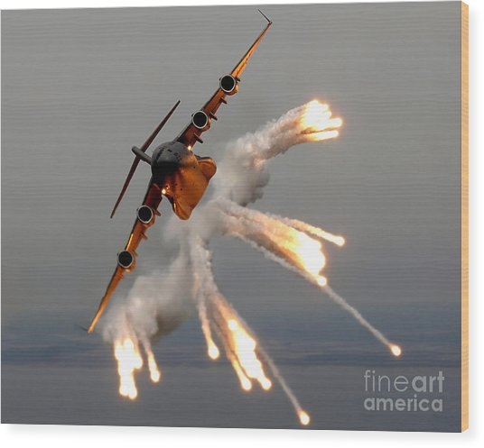 Wood Print featuring the photograph A C-17 Globemaster IIi Releases Flares by Stocktrek Images