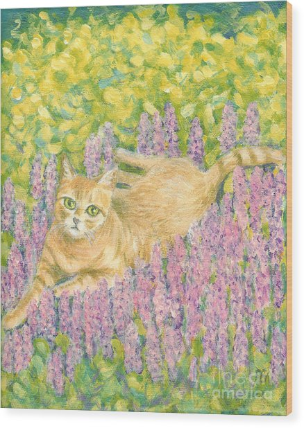 A Cat Lying On Floral Mat Wood Print