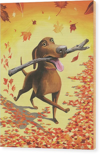 A Dog Carries A Stick Through Fall Leaves Wood Print