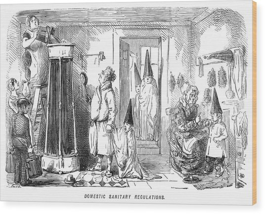 A Family Prepare To Partake Of  A Shower Wood Print by Mary Evans Picture Library